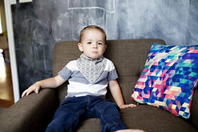 toddler-looking-grumpy-and-wearing-a-bib